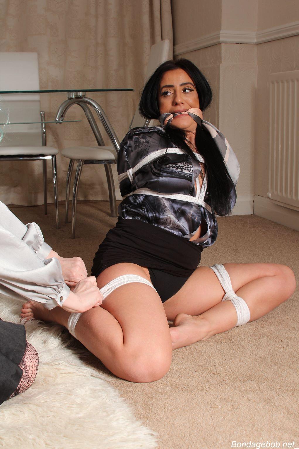 Tara May in bondage.