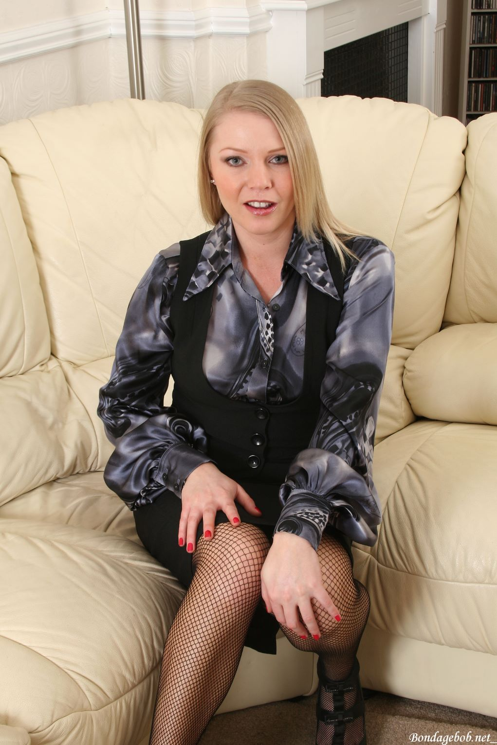 Abigail Toyne in a blouse posing.