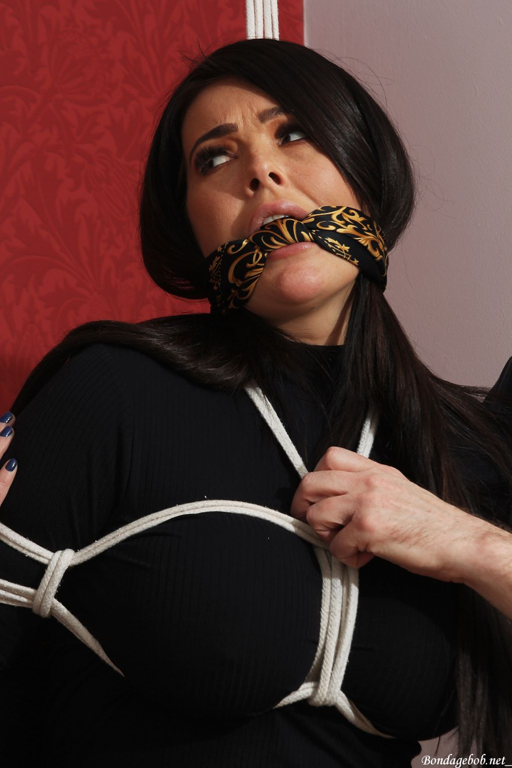 Charley Atwell & Temptress Kate in bondage.